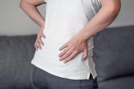 Lage rugpijn symptomen oorzaken behandeling